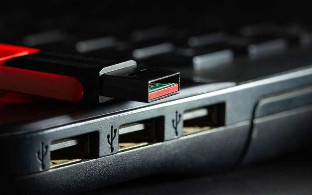 Graphic: a USB that represents using trustworthy USB devices only to avoid firmware vulnerabilities and malware.