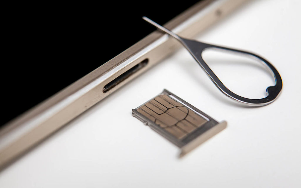 An illustration of a SIM card being swapped out